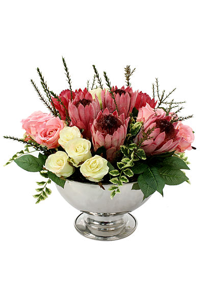 Roses and King proteas in different shade of pink in chrome rose bowl