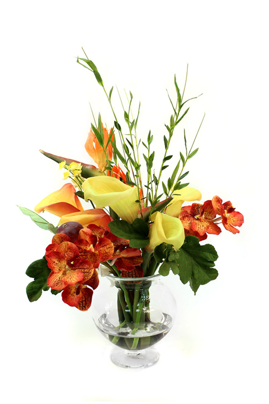 Quality artificial arrangement with orchids, calla lilies and bamboo sprics providing a rustic look
