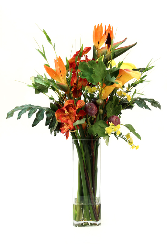 Beautiful artificial arrangement consisting of Tall birds of paradise, yellow calla lilies, orange orchid, bamboo greenery with spots of burgundy