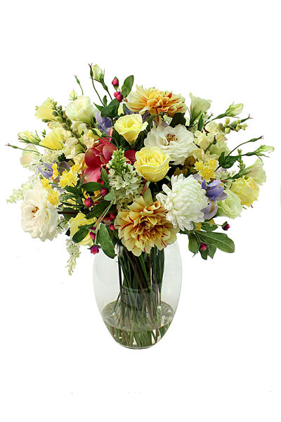 A happy bunch of mixed cut flowers in tones of cream and yellow with popping spots of color