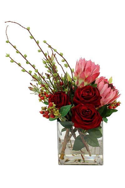 Velvet red roses and pale pink king proteas with greenery