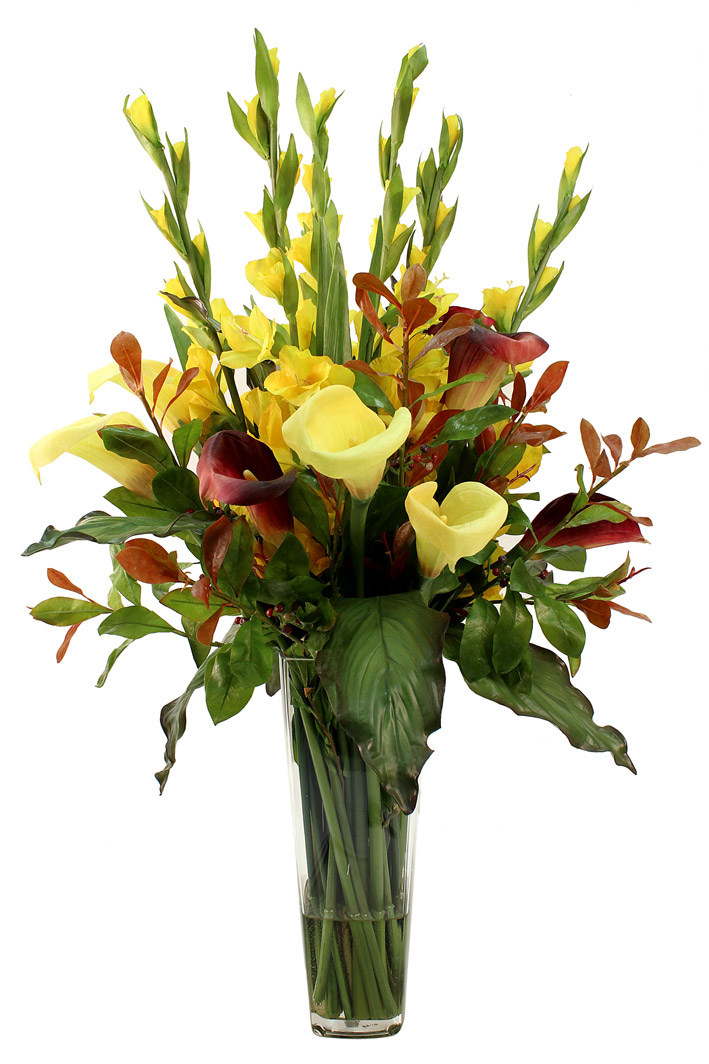 Yellow gladioli and calla lilies between interesting autumn leaves, greenery and aubergine calla lilies