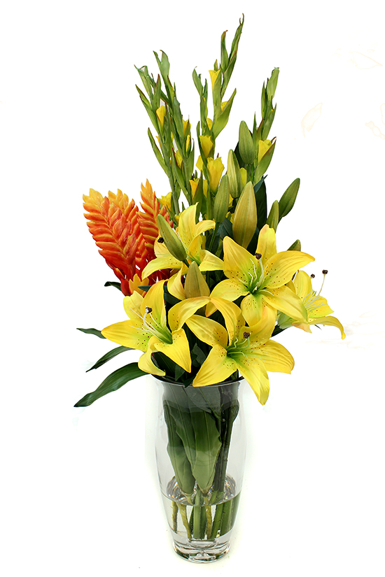 Yellow lilies and gladiolus with an orange bromeliad
