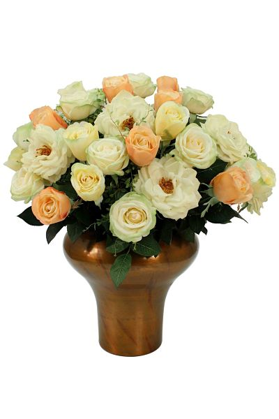 A full arrangement of artificial roses in pastel and cream colours
